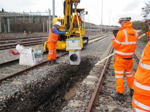 People fixing rail line